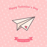 Paper plane decorated with heart.