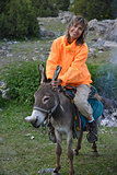 Smiling woman on donkey
