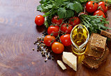 Italian food ingredients - vegetables, olive oil, spices and pasta