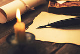 writing letter in candlelight. vintage items on the table