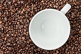 Coffee Beans Background with Empty White Coffee Cup
