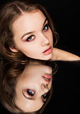 Beauty makeup fashion model on mirror  reflection