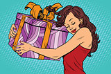 Beautiful young woman hugging gift box