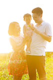 Family outdoor portrait in sunset