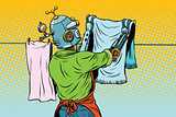 Vintage robot employee hangs up to dry clothes