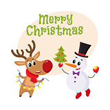 Snowman holding Christmas tree and reindeer with a garland