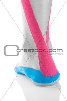 Kinesio tape on female heel.