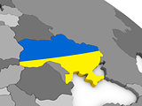 Ukraine on globe with flag