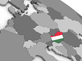Hungary on globe with flag