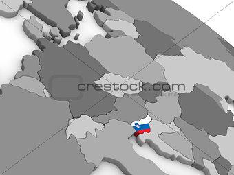 Slovenia on globe with flag