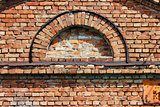 texture semi-circular window in the old historic brick building.