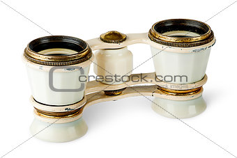 Old vintage pair of opera glasses vertically flipped