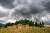 Beautiful dramatic clouds over autumn mountains. Carpathian mountains. Ukraine.