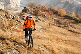 Bike cyclist with red backpack riding single track