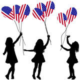 Girls silhouettes with US patriotic balloons