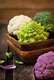Fresh organic white and purple cauliflower, broccoli, romanesco