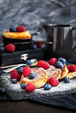 Cottage cheese pancakes decorated with fresh berries