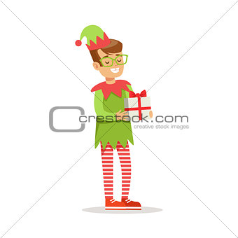 Boy in Glasses With Present Dressed As Santa Claus Christmas Elf For The Costume Holiday Carnival Party