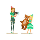 Woman Taking Pictures With Girl And Teddy Bear, Kids Birthday Party Scene With Cartoon Smiling Character