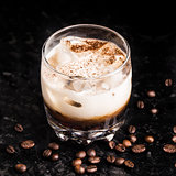 White russian with coffee beans on a table