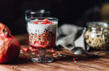 Pomegranate Parfait with Ingredients on Backdrop