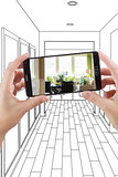 Hands Holding Smart Phone Displaying Photo of House Hallway Draw