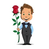 Happy little boy gives a red rose