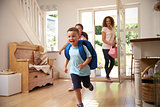 Excited Children Returning Home From School With Mother
