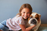 Portrait Of Smiling Girl With Pet British Bulldog