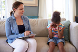Young Girl With Problems Talking With Counselor At Home