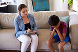 Young Boy With Problems Talking With Counselor At Home
