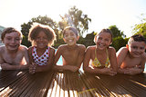 Portrait Of Children Having Fun In Outdoor Swimming Pool