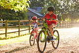 Two Children On Cycle Ride Together