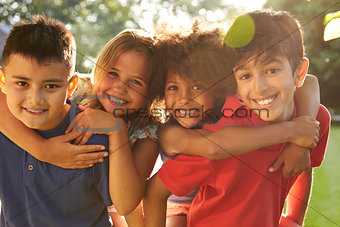 Portrait Of Four Children Having Fun Outdoors Together
