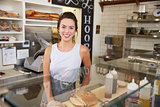 Female business owner behind the counter at a sandwich bar
