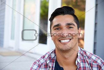 Portrait Of Man Sitting On Steps Outside Home