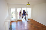 High Angle View Of  Family Exploring New Home On Moving Day
