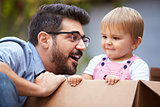 Father Playing With Son In Cardboard Box