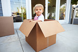 Little Boy Playing Inside Moving In Box