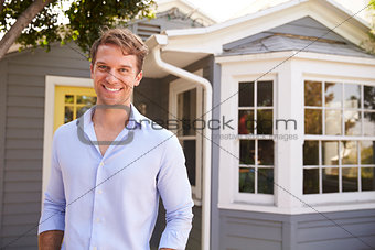 Portrait Of Man Standing Outside New Home
