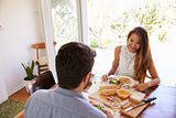 Couple Enjoying Meal At Home Together