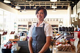 Portrait Of Female Employee Working In Delicatessen