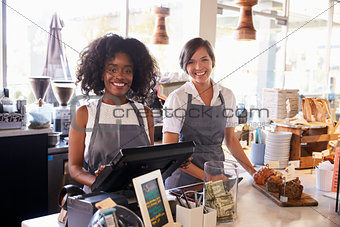 Portrait Of Female Staff Working At Delicatessen Checkout