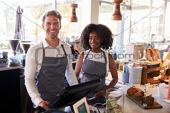 Portrait Of Staff Working At Delicatessen Checkout