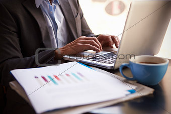 Close Up Of  Businessman Working On Laptop By Office Window