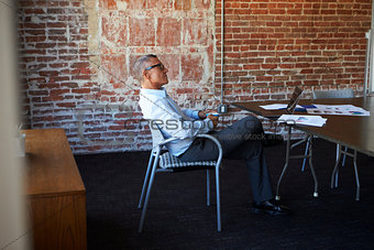 Thoughtful Mature Businessman In Boardroom
