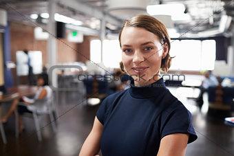 Portrait Of Businesswoman In Modern Open Plan Office