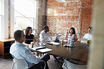 Group Of Businesspeople Meeting In Modern Boardroom