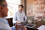 Businessmen Having Creative Brainstorming Meeting In Office