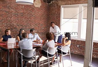 Businessman Addressing Boardroom Meeting